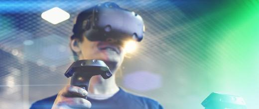 young man use virtual reality goggles or vr headset or helmet play videogame with wireless controller